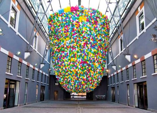 Enormous Beehive Made Of Recycled Plastic Bags Dangles At