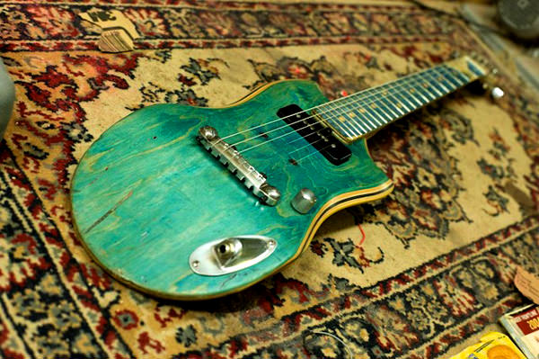 electric guitars made from old skateboard decks