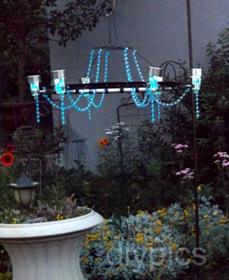 Diy chandelier with solar lights gift ideas creative spotting here in an easy and inexpensive solar powered chandelier you can make for your next garden or beach party this poor bicycle rim has gone through several mozeypictures Image collections