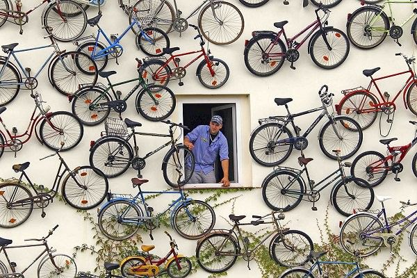 German Bike Shop Decorated with 120 Bicycles Stuck to Its Storefront Sustainability