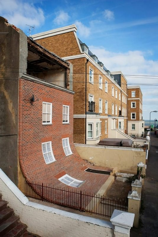 Alex Chinneck's Surreal Brick House Architecture + Interiors