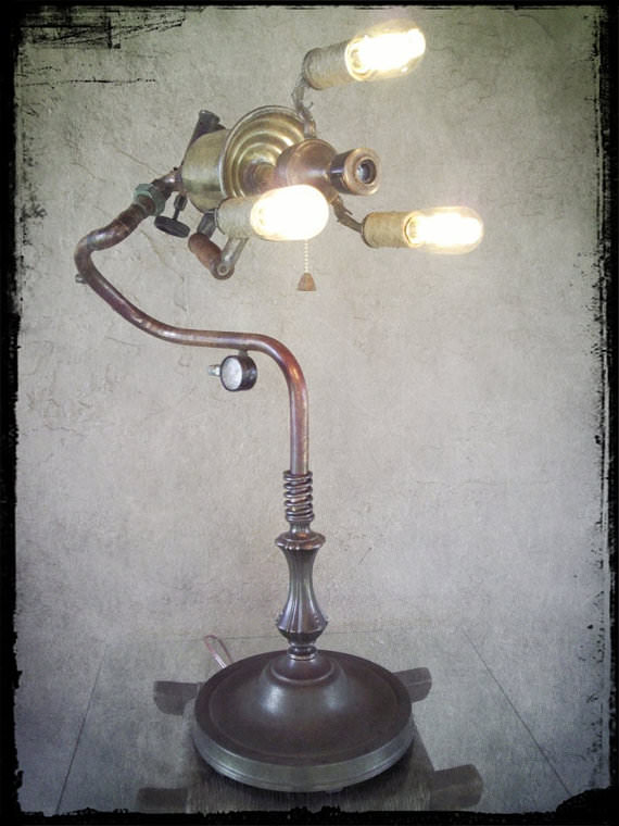 It was assembled using a variety of parts including a vintage blow torch recycled copper piping and fittings brass unions a donor lamp
