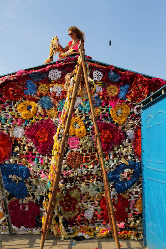 India Homeless Shelter Covered With Technicolor Yarn by Olek Art + Graphics