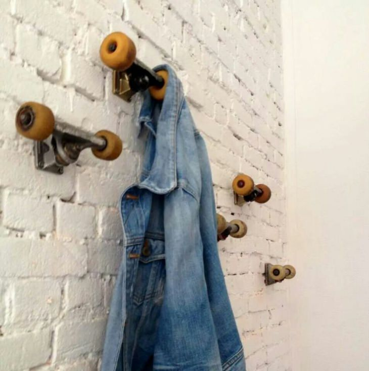 Old skateboard trucks turned into coat hanger gift ideas for Cool wall hook ideas