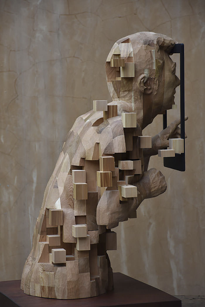 these pixelated sculptures that look like computer glitches are actually made from wood gift. Black Bedroom Furniture Sets. Home Design Ideas